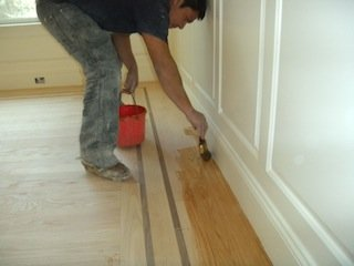 applying wood floor finish