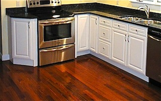Mahogany Hardwood Floor In White Kitchen